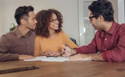 Young couple meeting bank lender